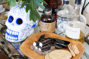 A detail of items on a bar cart.