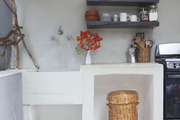 Wooden floating shelves in a kitchen