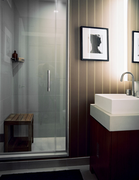 Bathroom Modern - A wooden stool in a shower and striped walls in a bathroom