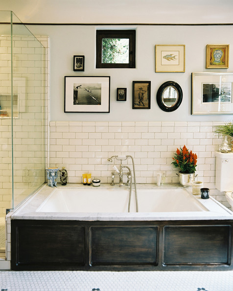 Bathroom Tiles - Framed art and white subway tile above a large bathtub