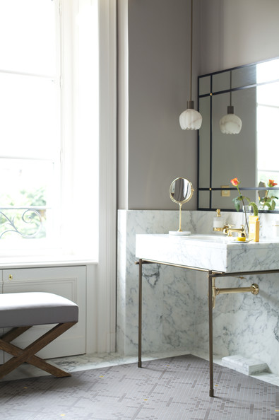 Bathroom - A sleek marble sink accented by gray walls