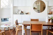 A white dining space with natural wood accents.