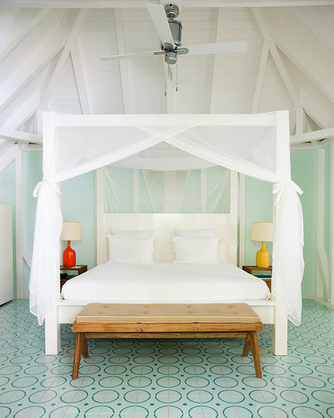Bedroom - A four-poster bed with mosquito netting at La Banane