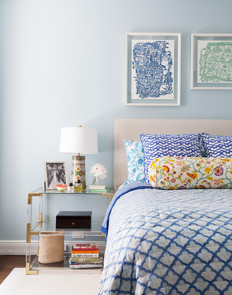 Bedroom - A tiered bedside table in a pattern-filled bedroom
