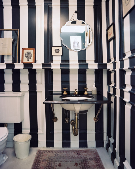 Black Bathroom - A bathroom with black-and-white stripes and a patterned rug