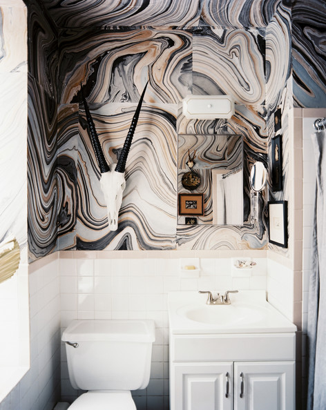Bohemian Bathroom - Marbleized paper and white tile in a bathroom