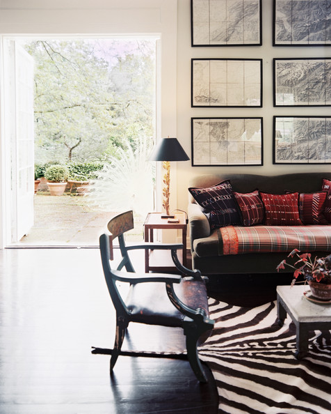 Bohemian Living Room - A seating arrangement with a zebra-print rug
