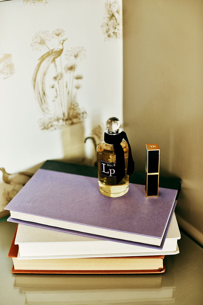 Books - Cosmetics and books on a vanity at Palihouse Santa Monica