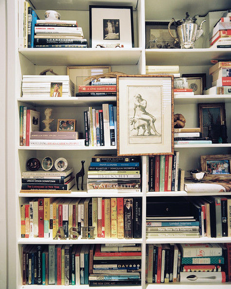 Bookshelf - Built-in shelves filled with framed art and books