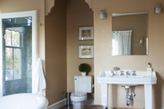 A toilet in a framed alcove