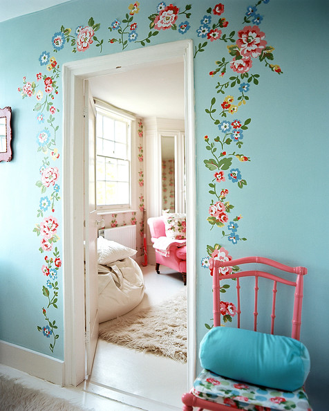 Cath Kidston - A pink chair beside blue walls decorated with flowers