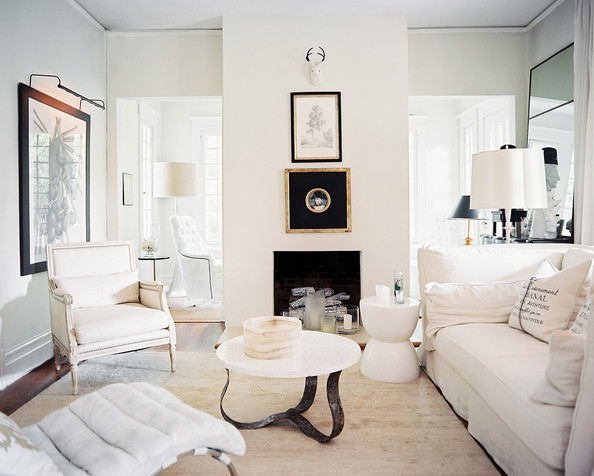 Colonial Living Room - Framed art and white upholstered furniture in a neutral living room
