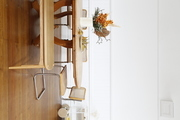 An wooden dining table and vintage chairs.