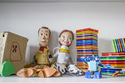A collection of well-loved toys in a playroom