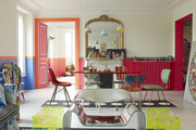 A Lucite table and pendant lights in a Paris dining room