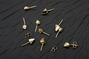 Purposely mismatched enamel-and-brass earrings by Cold Picnic