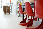 Red midcentury dining chairs at Buckingham Interiors + Design