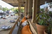 A sidewalk table and banquette at the District Miami