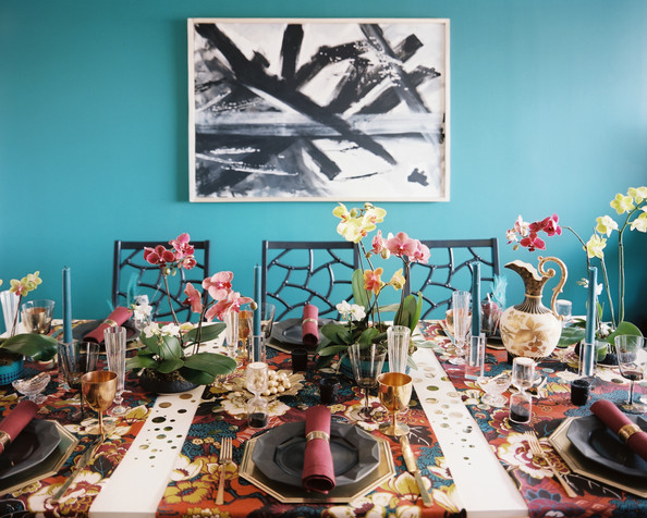 December 2012 Issue - Folding chairs from Society Social surrounding a festive table set with colorful runners