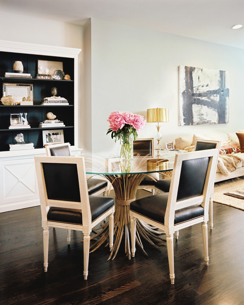 Dining Room - A glass-topped dining table paired with black leather chairs