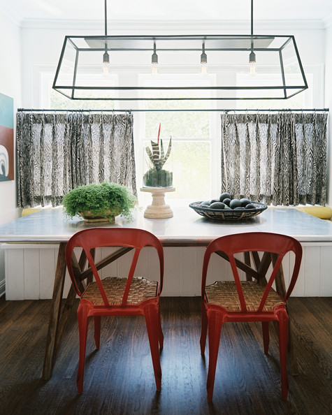 Dining Table With Bench An Iron And Glass Chandelier Suspended Above