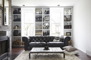 Floor-to-ceiling shelving in a living room.