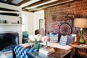 A rustic wooden coffee table in a living space filled with pattern