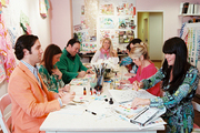 Lilly Pulitzer artists painting at a white conference table