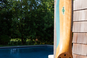 A propeller on display beside a pool