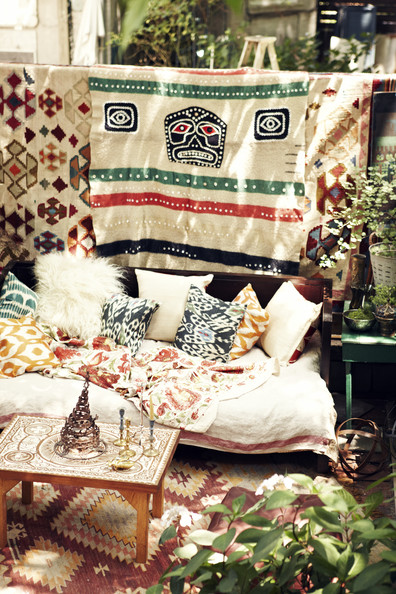 Eclectic - A daybed dressed with patterned pillows in an alfresco living space