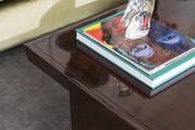 A coffee table corner with design books