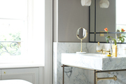 A sleek marble sink accented by gray walls