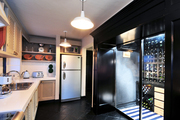 A contemporary kitchen with a wine cellar attached.