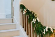 A detail of a garland on a railing.