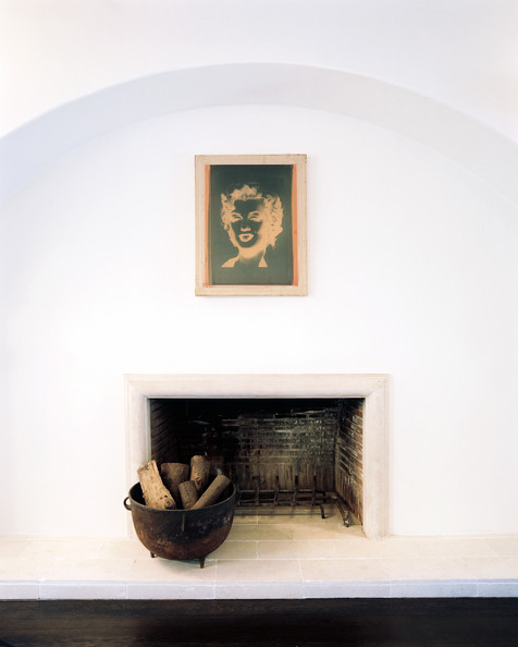 Fireplace - A negative-exposure artwork of Marilyn Monroe hung above a fireplace