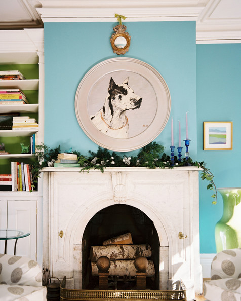 Fireplace - A portrait of a dog above a mantel decorated for the holidays