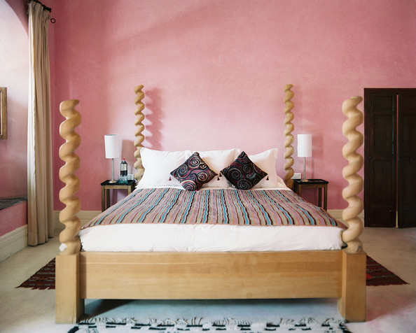 Four Poster Bed - A barley-twist four-poster bed in a pink guest room