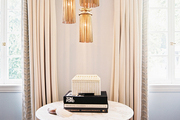 A vintage light fixture above a marble side table
