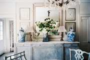 A dining sideboard decorated with blue-and-white ginger jars