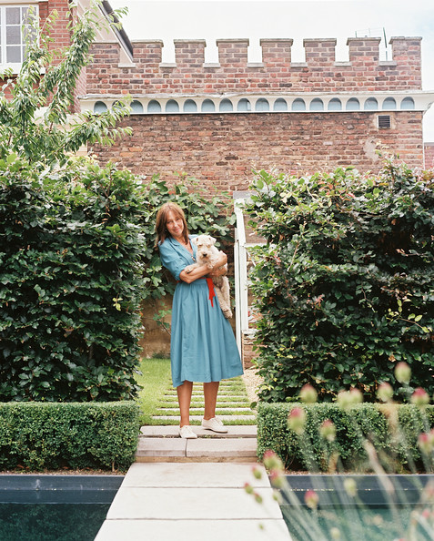 Garden - Cath Kidston with her Lakeland terrier, Stanley, outside her home in Chiswick, England