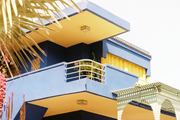 A blue-and-yellow exterior color scheme