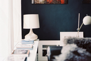 Black walls hung with art