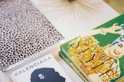 Books and decorative accessories on a white coffee table