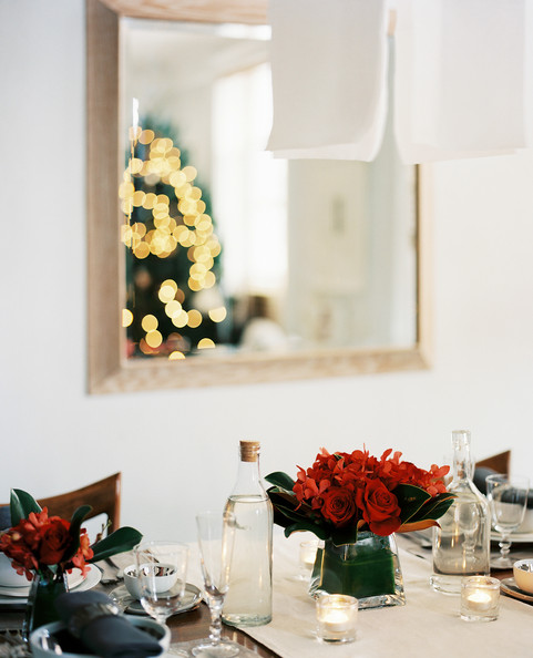 Holiday Decor - Vases of red flowers on an elegantly set holiday table