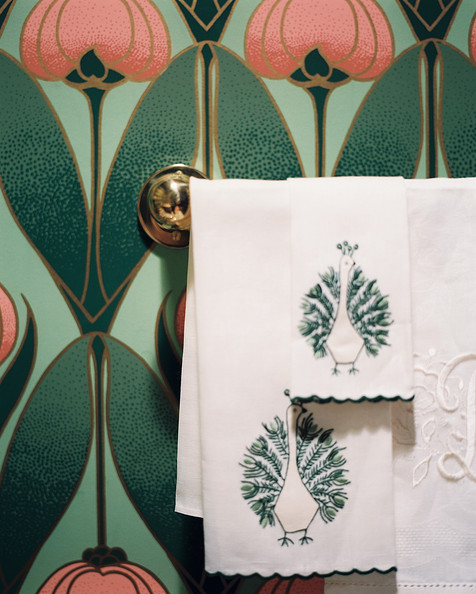Hollywood Regency Wall Treatment - Monogrammed and embroidered hand towels in a powder room with floral wallpaper