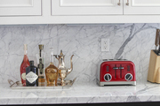 Red toaster and silver tray with drinks supplies spark an L.A. kitchen