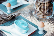 A table setting celebrating the arrival of spring with blue accents