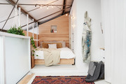 A small bedroom nook in a loft.