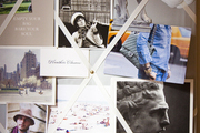 An inspiration board of photographs, quotations, and mementos