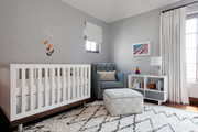 Tonal nursery with vibrant decor and contemporary furniture.